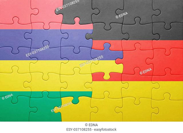 puzzle with the national flag of germany and mauritius . concept