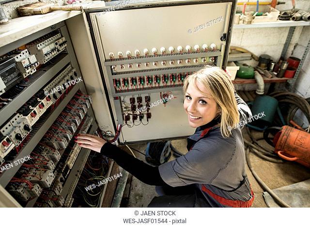 Woman checking fuse box