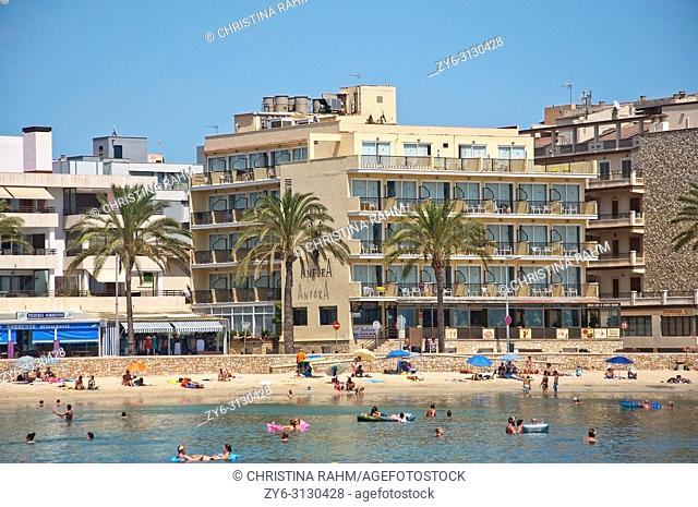 MALLORCA, SPAIN - JULY 21, 2012: Can Pastilla beach hotels and people on a sunny summer day on on July 21, 2012 in Mallorca, Spain