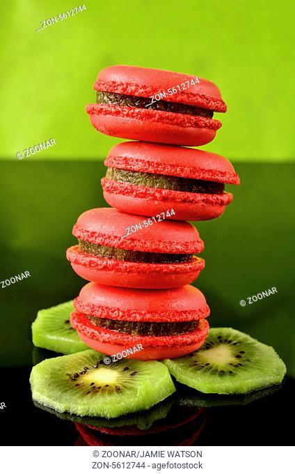 Raspberry and Kiwi macaroon stacks on a bed of kiwi slices