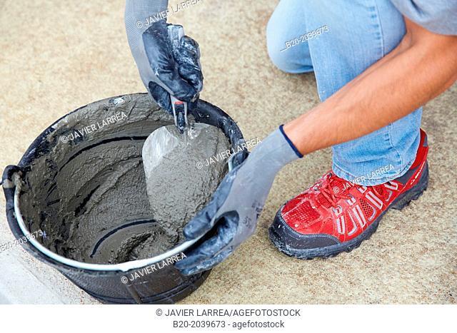 Bricklayer making cement mortar. Construction of residential building. Donostia. San Sebastian. Gipuzkoa. Basque Country. Spain