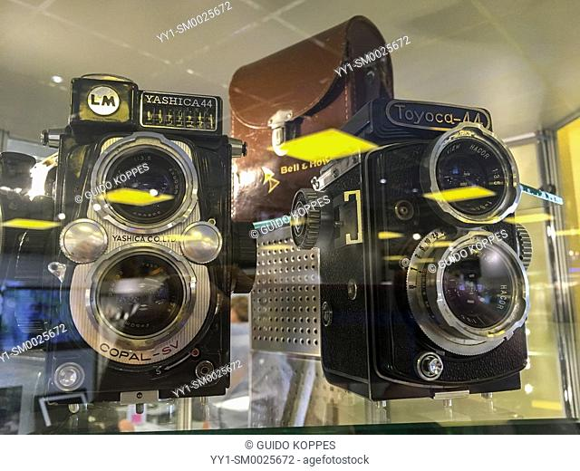 Eindhoven, Netherlands. Two vintage and analog phtography film camera's on display inside a digital photography equipment store