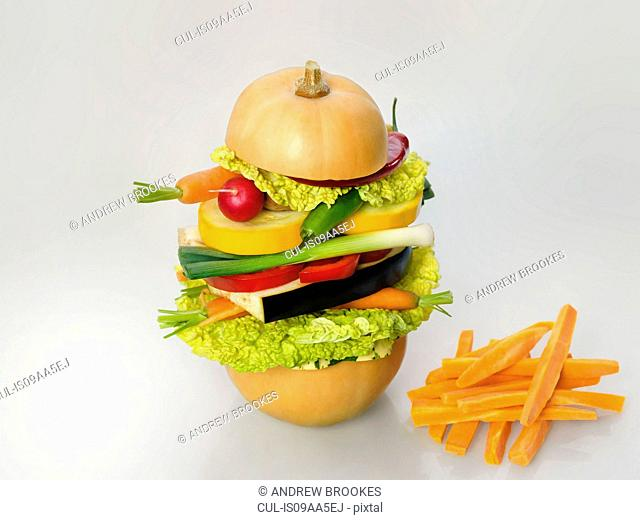 Healthy diet illustrated by a raw vegetarian burger and carrot chips