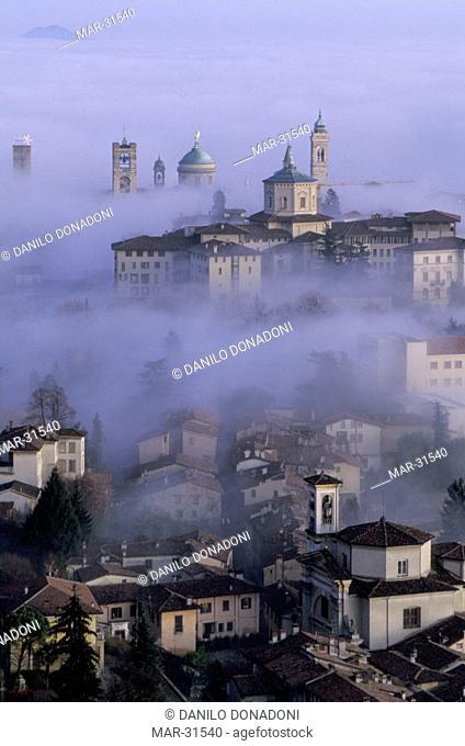 sunrise and fog, bergamo, italy