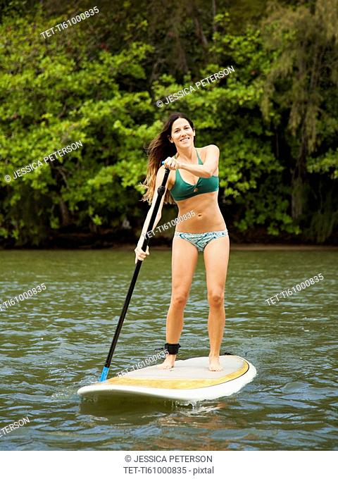 Young woman paddling in sea