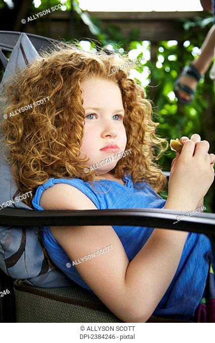 Portrait of a young girl with red curly hair; Guelph, Ontario, Canada