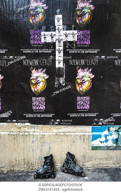 posters for nolwenn leroy album and photograhs of crucified jesus christ forming a cross, inline skates, paris, ile de france, france