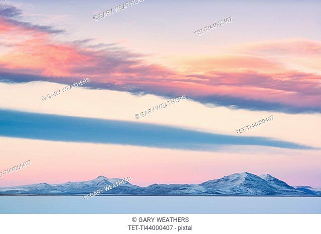 USA, Oregon, Alford Desert, Winter Sunset over mountains