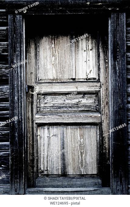 Black & White old wooden door for background usage taken in the old Stockholm city, Sweden