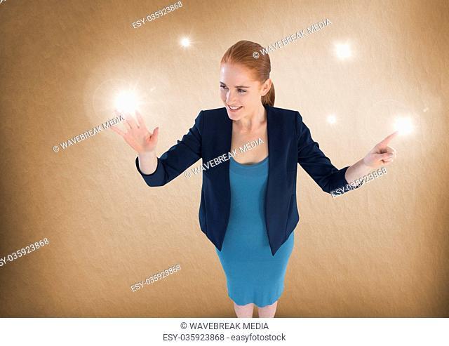Businesswoman touching sparkling lights