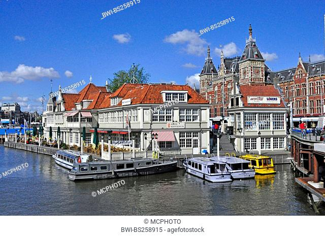 main railway station with boat landing pier in the foreground, Netherlands, Amsterdam