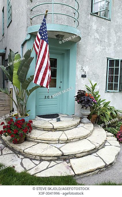 Old Faithful US Flag garnishing the doorway of an Art Deco style home. St Paul Minnesota MN USA