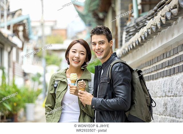 Young smiling couple at Korean village