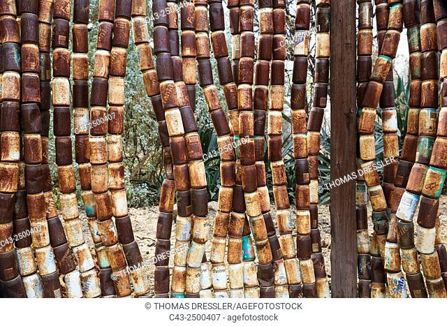 Fence made of old, rusty tins in the garden of a restaurant in the town of Omaruru, Namibia