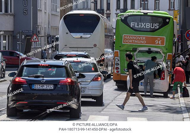 13 July 2018, Germany, Frankfurt: Buses blocking traffic at the central station. There are constant chaotic transport scences at the bus parking area on the...