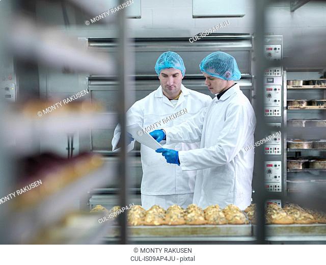 Bakers in meeting in cake factory