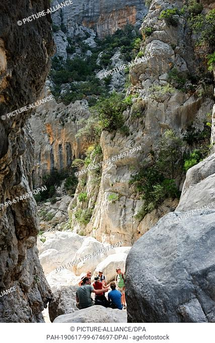 06 June 2019, Italy, Nuoro: The entrance to Gola Gorropu, a gorge in the Supramonte Mountains of the island of Sardinia. It is one of the deepest gorges in...