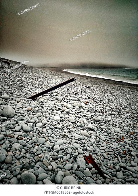 Pebbled beach with old sea defence in Aberystwyth Wales UK