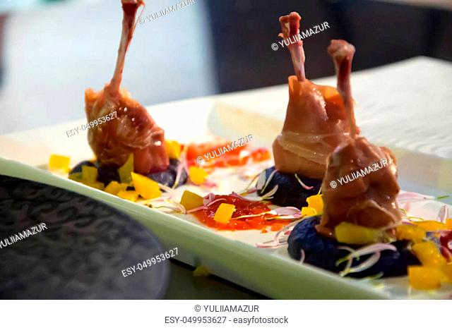 Roasted quail with salad. Exclusive dish. Beautiful still life of food