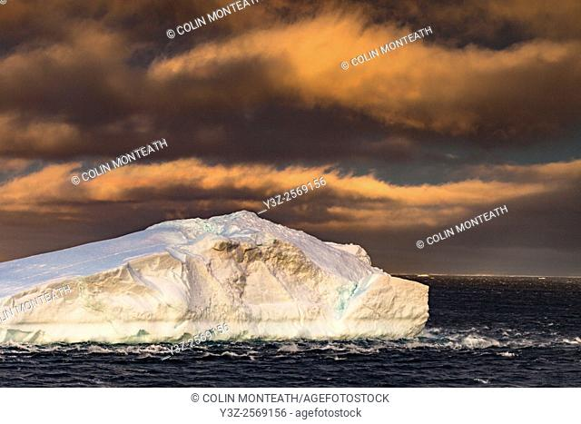 Storm clouds at sunset, icebergs in bay, Cape Adare, North Victoria Land
