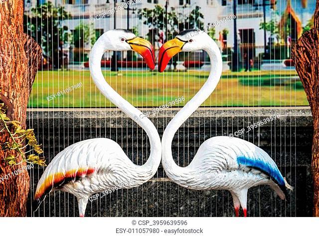 white flamingo's neck forming heart shape