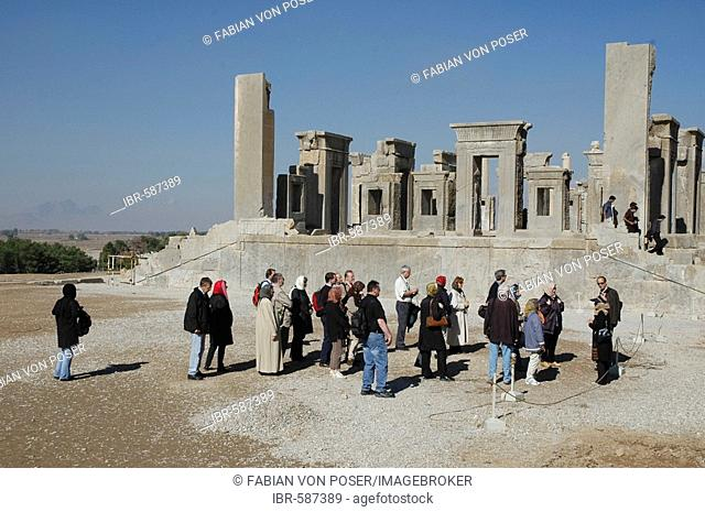 Tourists in front of Dareios palace, Persepolis, Iran