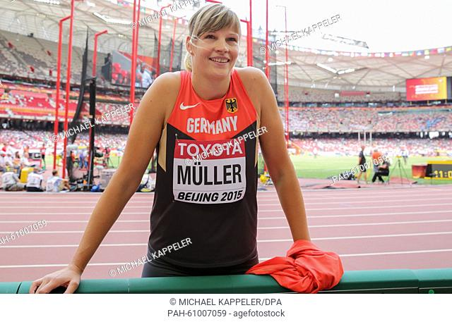 Germany's Nadine Mueller chats to her coach at the Discus Throw Qualification on the 15th International Association of Athletics Federations (IAAF) Athletics...