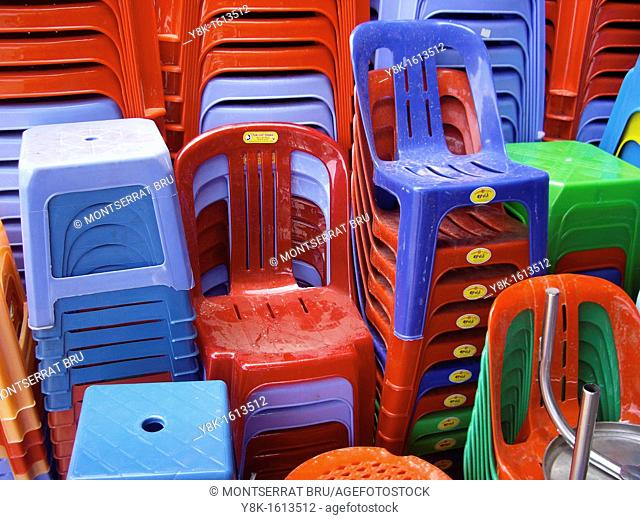 Coloured plastic chairs and stools at Kampot market, Cambodia