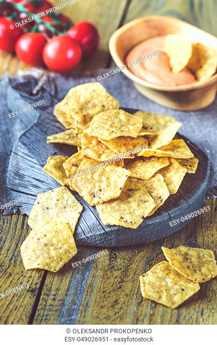 Tortilla chips with chile con queso - dip made of melted cheese and chilli pepper