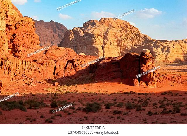 Red mountains of the canyon of Wadi Rum desert in Jordan. Wadi Rum also known as The Valley of the Moon is a valley cut into the sandstone and granite rock in...