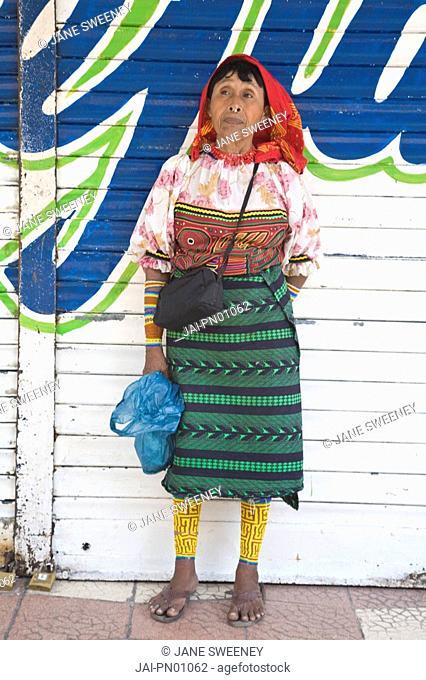 Panama, Panama City, Casco Viejo San Felipe, A Kuna Indian woman standing infront of building