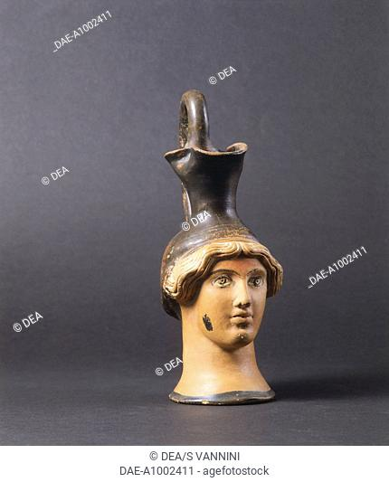 Head shaped perfume vessel. Etruscan Civilization, 5th Century BC.  Fiesole, Archaeological Museum