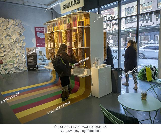 Visitors sample snacks at the Brandless Pop-Up With a Purpose in the Meatpacking District in New York on Wednesday, October 24, 2018