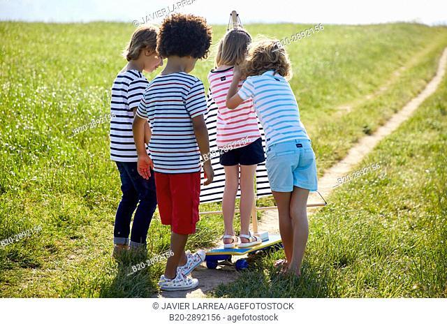 Kids playing with skateboard, Zarautz, Gipuzkoa, Basque Country, Spain, Europe