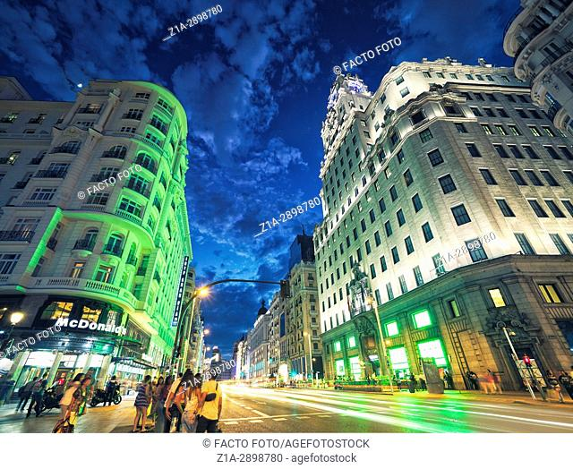 Nightlife at Gran Via avenue crossing Montera street . Madrid. Spain