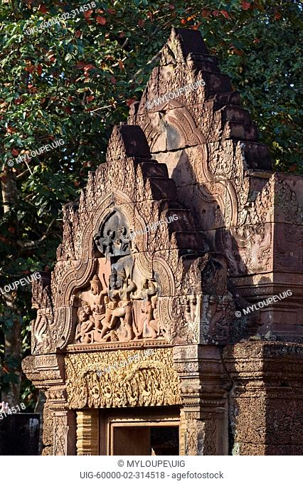 Red sandstone bas relief of Valin and Sugriva fighting on the W pediment of Gopura 1 at Banteay Srei, 10th century Khmer architecture at Angkor Wat - Siem Reap