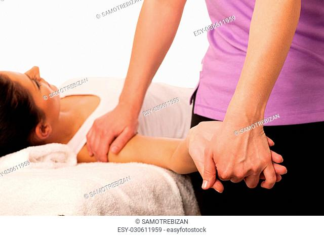 physiotherapy -therapist excercising with patient , working on arm stretching