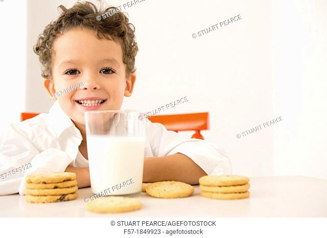 Four year old boy with milk and cookies for breakfast