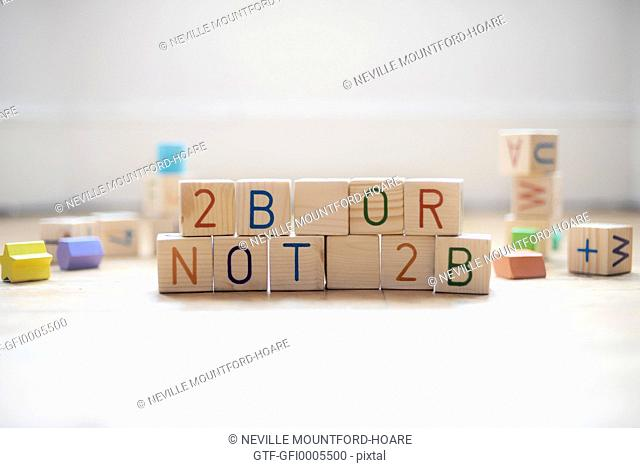 baby play blocks spelling out 2b or not 2b