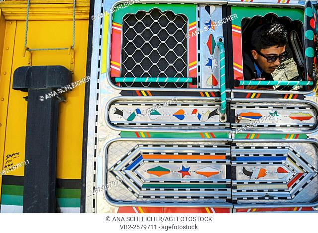 Driver of a goods delivery truck looking through the window in Nubra Valley (Indian Himalaya)