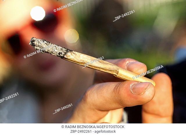 Close up, man smoking marijuana joint, Czech