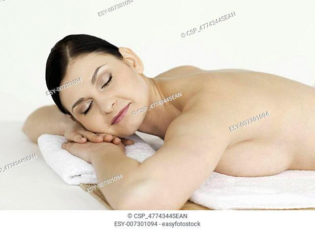 Cute dark-haired woman relaxing