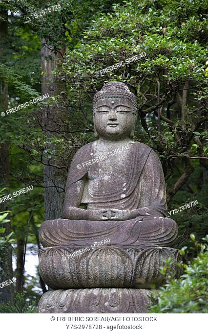 Buddha statue in the garden of Ryoan-ji temple, Kyoto, Japan, Asia