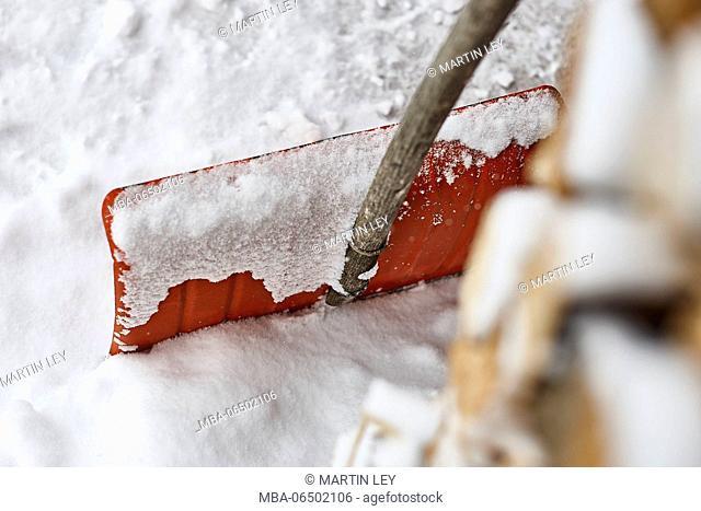Snow shovel, snow, wood pile, detail, medium close-up, blur