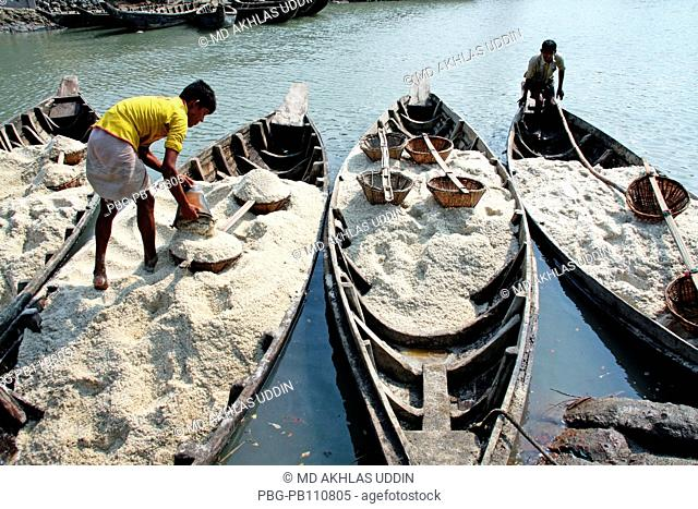 Boats loaded with salt that collect from a field at Bashkhali It is one of the oldest and most ubiquitous of food seasonings and used to preserve food Salt is...