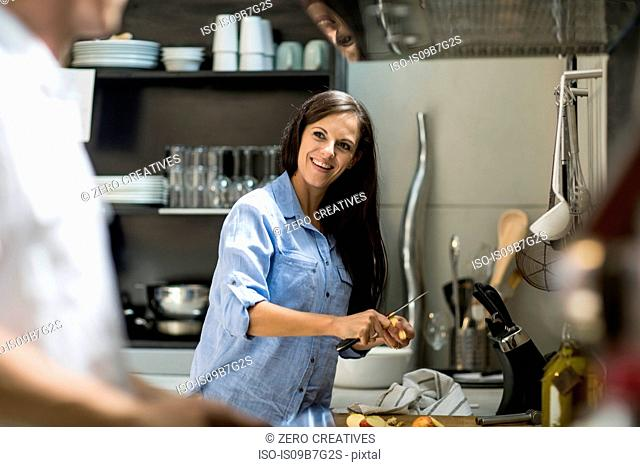 Husband and wife making preparations in kitchen