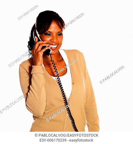 Adult woman speaking on phone against white background