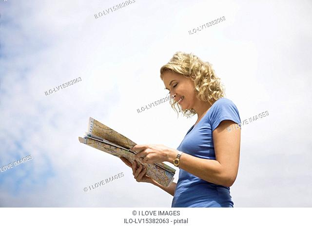 A middle-aged woman looking at a map