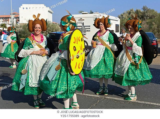 Carnival, Women disguised of Valencian Falleras, Isla Cristina, Huelva-province, Spain
