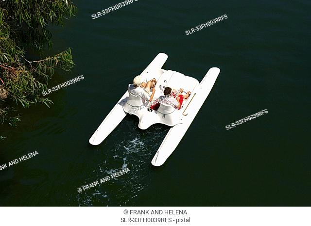 Couple in paddle boat on lake